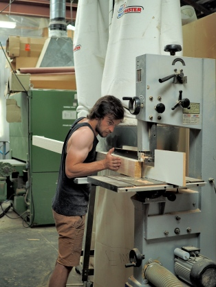 A bandsaw rips the timber into thin strips